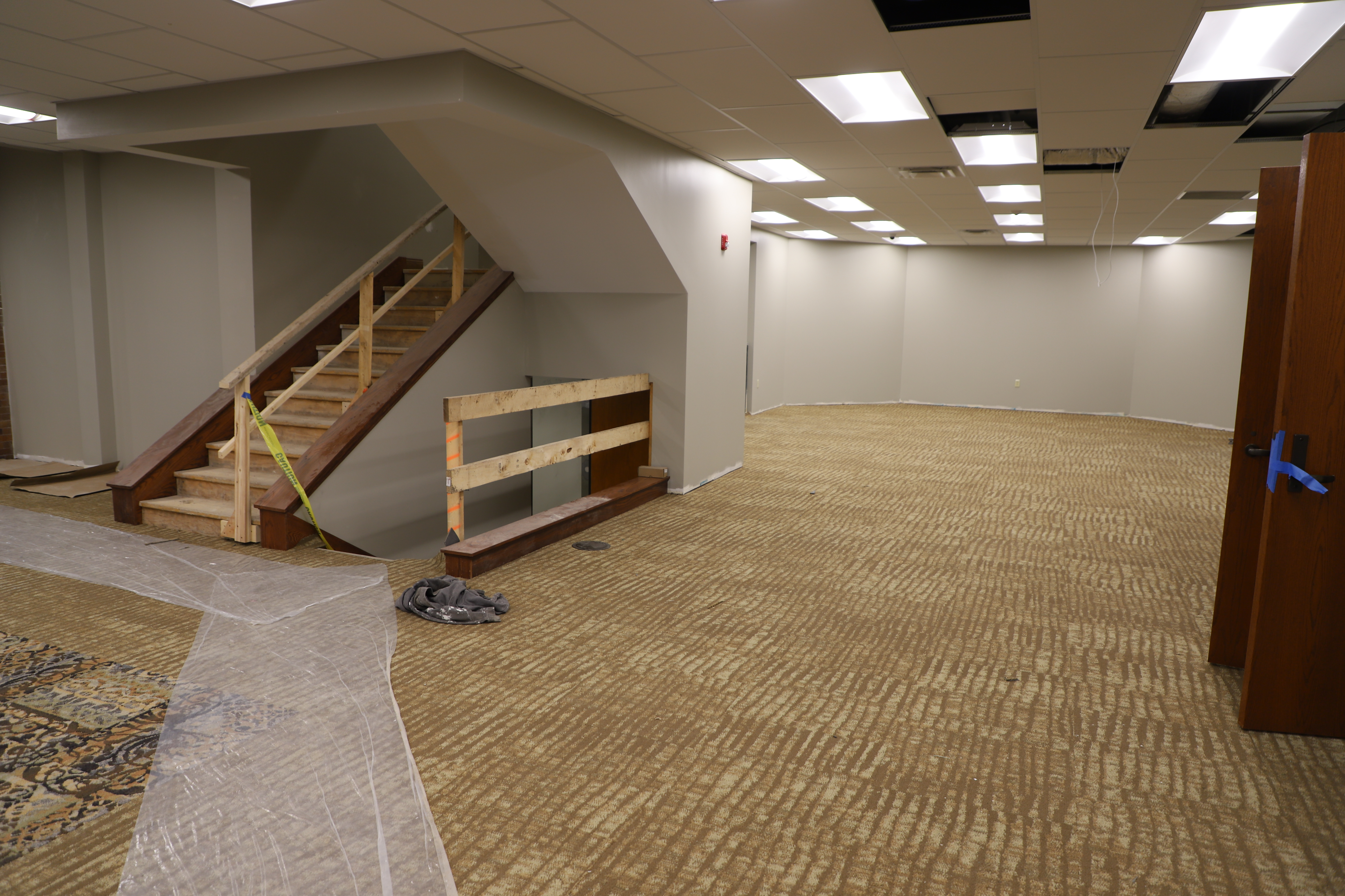 Image of inside of Eckhart Public Library, showing main floor with new beige carpet